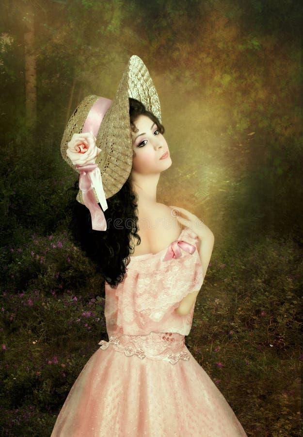 Menina em um chapéu de palha fotos de stock royalty free