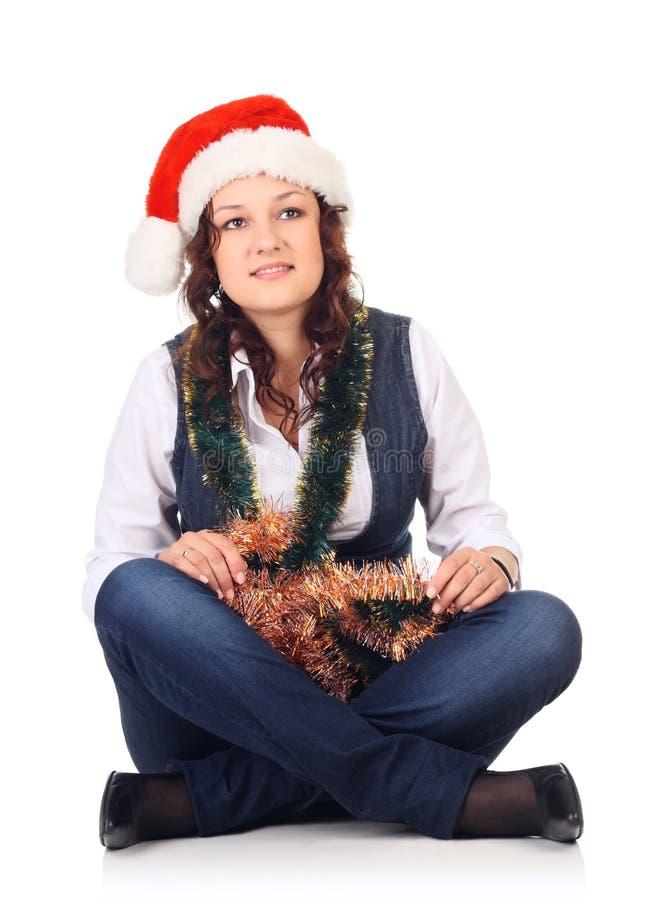 Menina em um chapéu de Santa com decoração do Natal imagens de stock