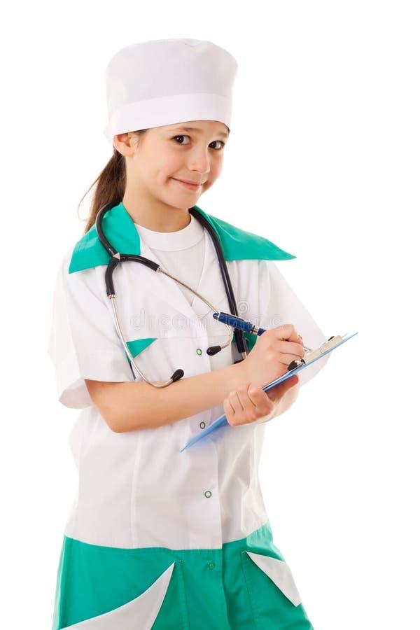 Menina em um traje do doutor imagem de stock