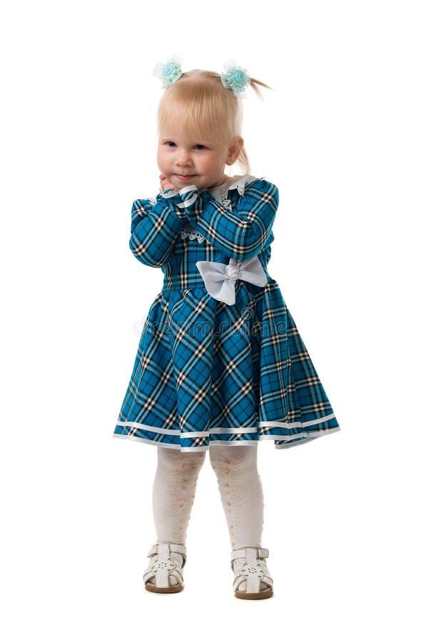 A menina em um vestido azul. imagem de stock