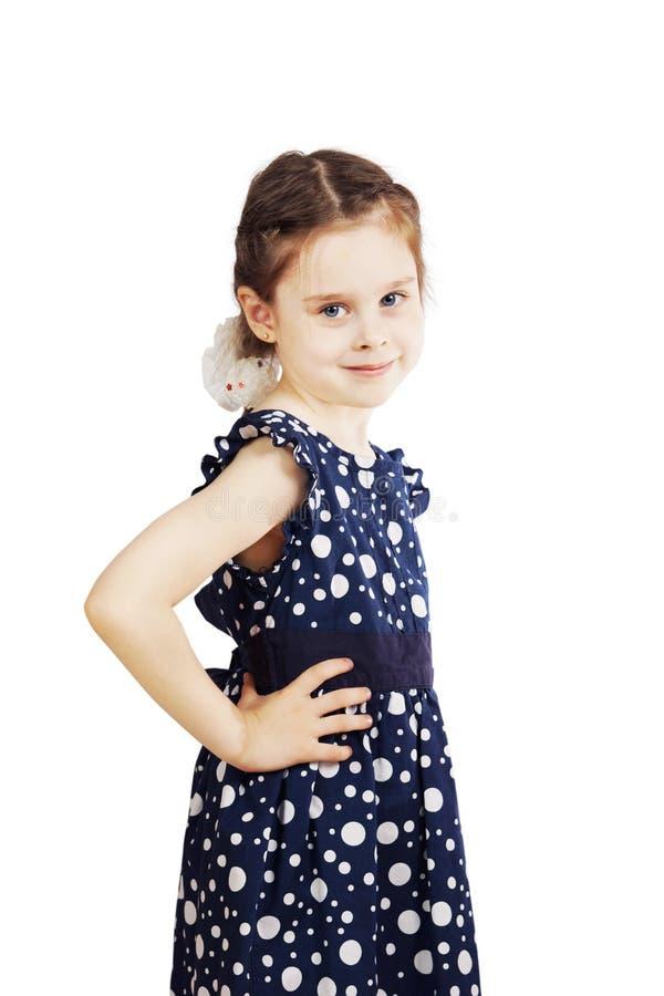 Menina em um vestido azul com às bolinhas fotografia de stock