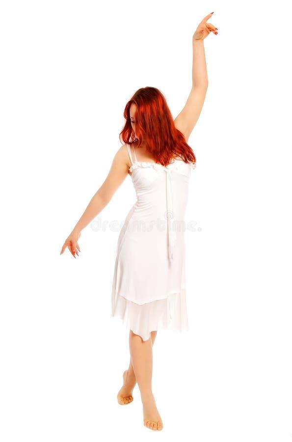 A menina em um vestido branco fotografia de stock royalty free