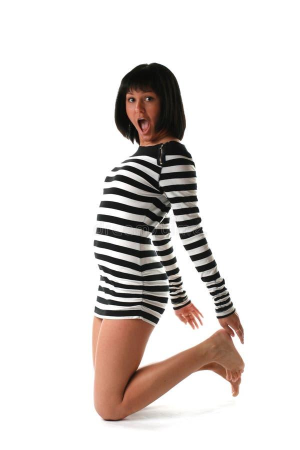 Menina em um vestido listrado fotografia de stock