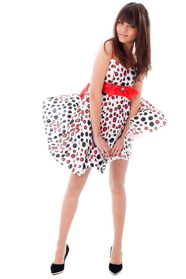 Menina em um vestido tornando-se foto de stock royalty free