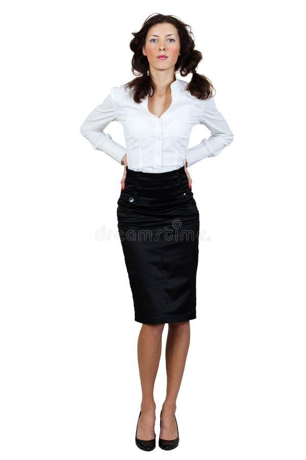 Menina em uma blusa e em uma saia fotos de stock
