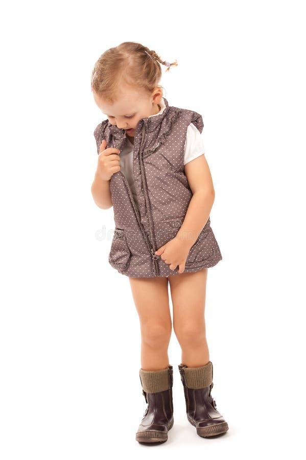 Menina em uma veste elegante e em carregadores fotografia de stock royalty free