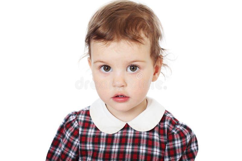 Menina em vestido checkered imagem de stock