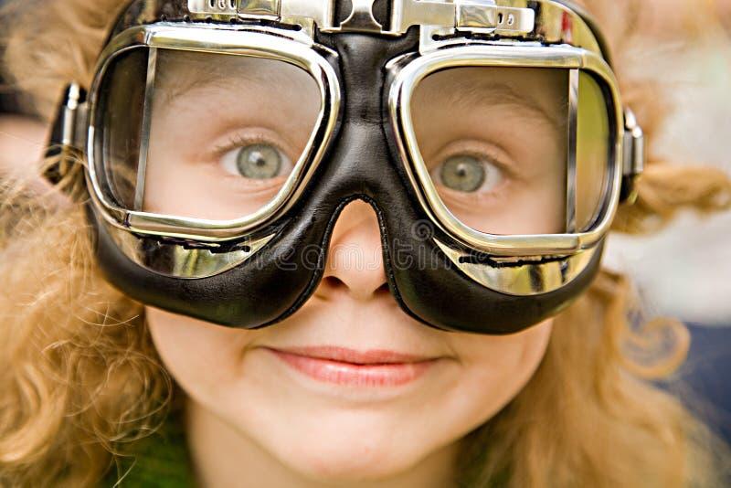 Menina em vidros da motocicleta imagens de stock royalty free