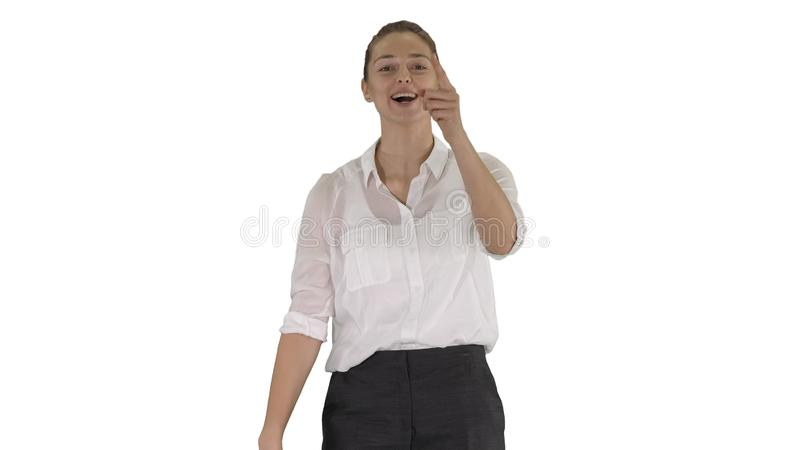 Menina emocional feliz das emoções humanas positivas que ri da parte inferior de seu coração no fundo branco imagem de stock
