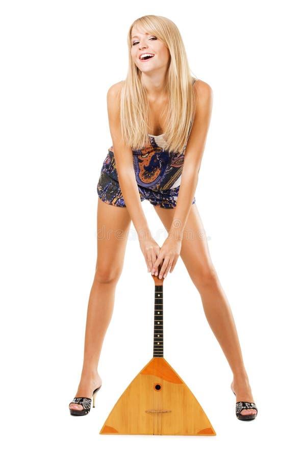 Menina encantadora com balalaika fotografia de stock