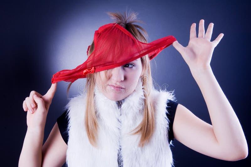 Menina engraçada com a cuecas na cabeça fotografia de stock royalty free