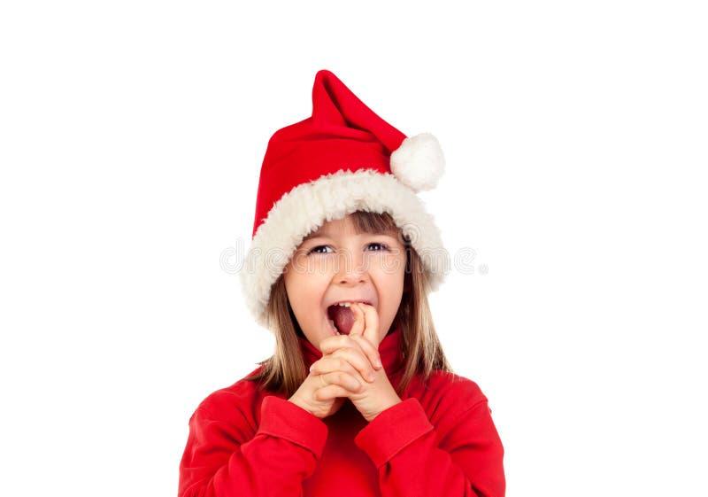 Menina engraçada louca com chapéu do Natal imagem de stock