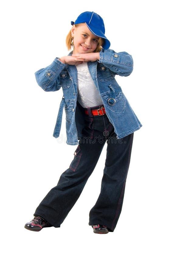 Menina engraçada pequena das calças de brim. imagem de stock royalty free
