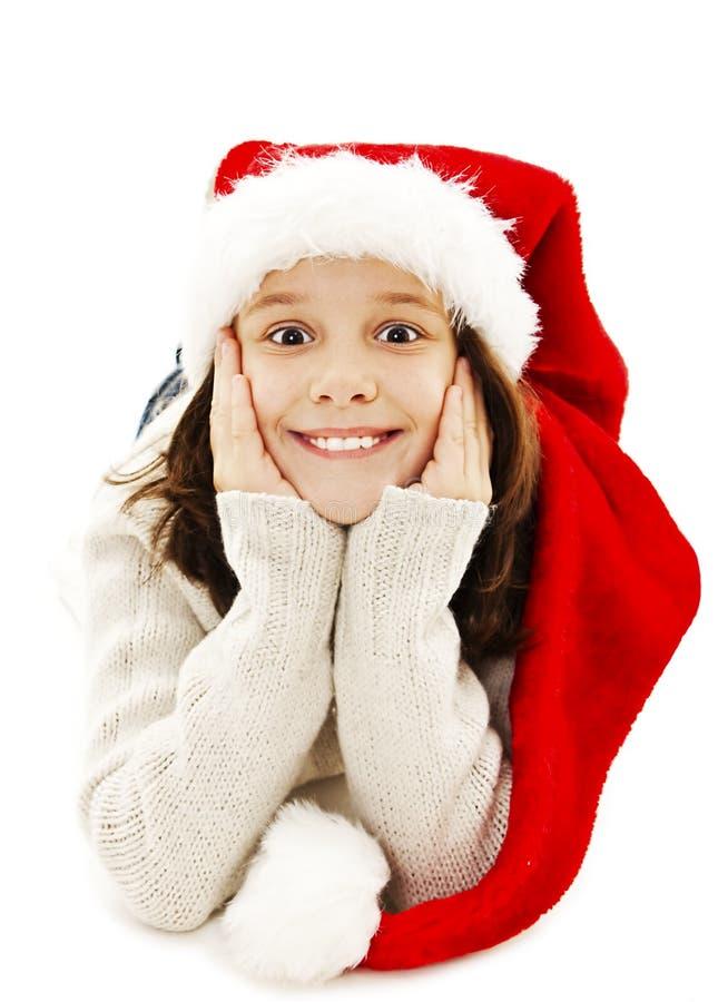Menina entusiasmado no chapéu vermelho de Santa imagens de stock royalty free
