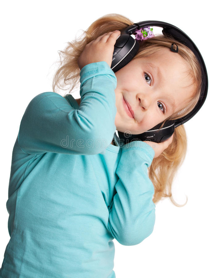 A menina escuta música fotografia de stock royalty free