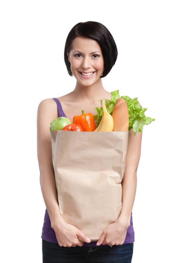 Menina esperta com o pacote de fruta e verdura imagens de stock royalty free