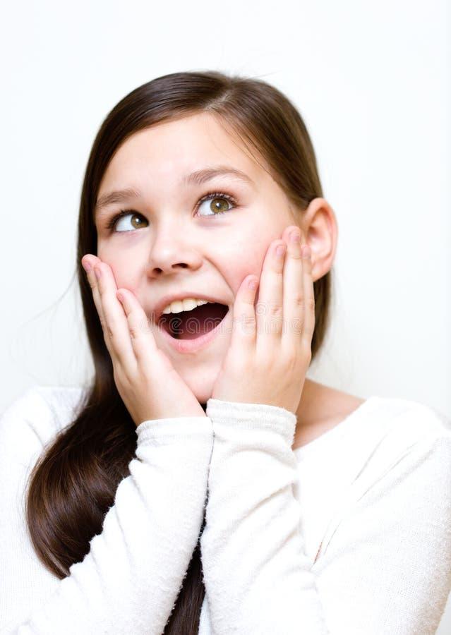 A menina está guardando sua cara na admiração fotografia de stock royalty free