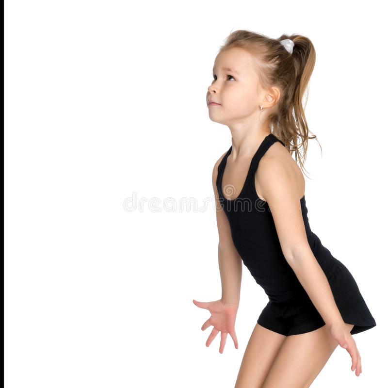 A menina está travando a bola foto de stock royalty free