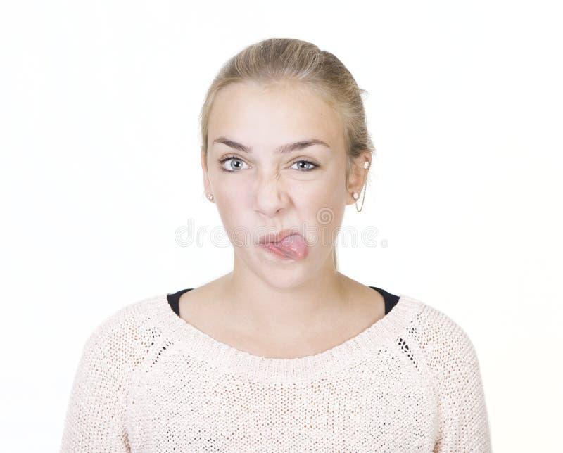 A menina esticou para fora sua língua imagens de stock royalty free