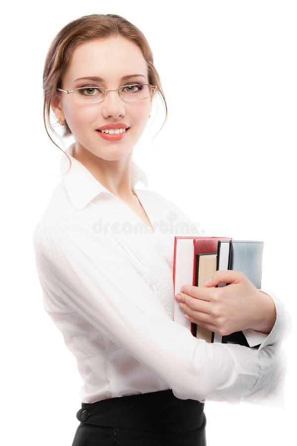 Menina-estudante de sorriso com livros de texto imagem de stock royalty free