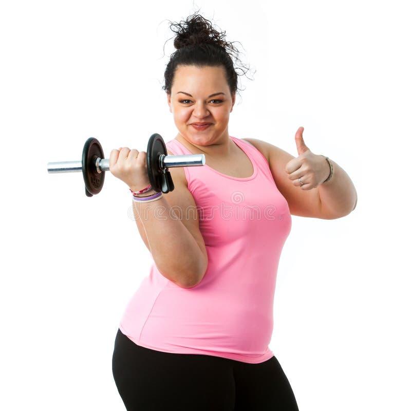 Menina excesso de peso da aptidão que faz os polegares acima fotos de stock