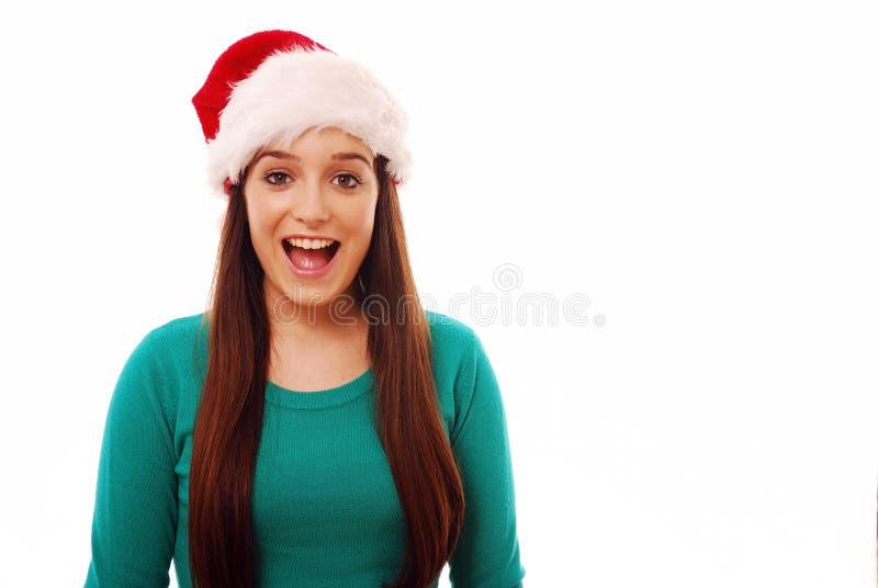 Menina Excited que desgasta o chapéu de Santa fotografia de stock