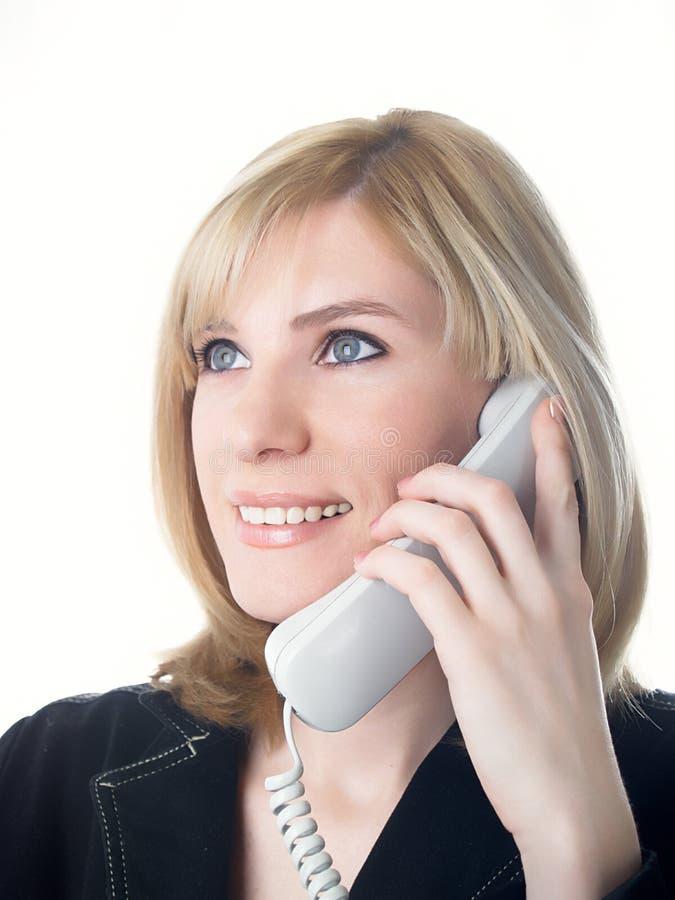 A menina fala no telefone foto de stock royalty free