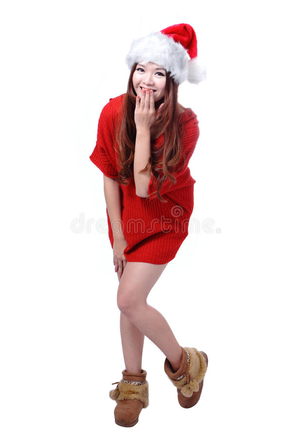 Menina feliz bonito do Natal com pano e o chapéu vermelhos imagens de stock