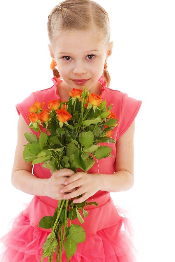 A menina feliz com aumentou na roupa vermelha imagem de stock