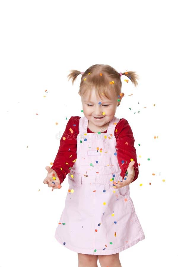 Menina feliz com confetti imagem de stock