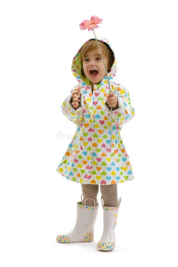 Menina feliz com flor imagens de stock royalty free