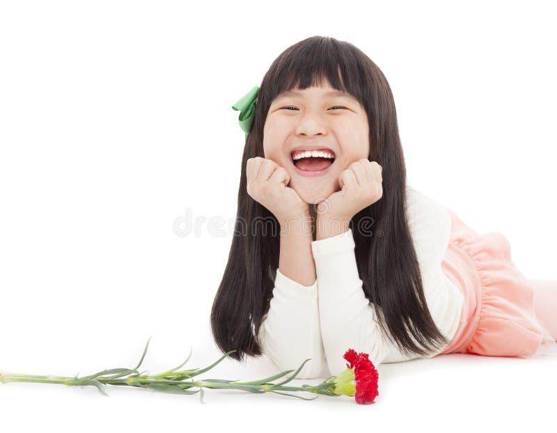 Menina feliz com flor do cravo imagem de stock