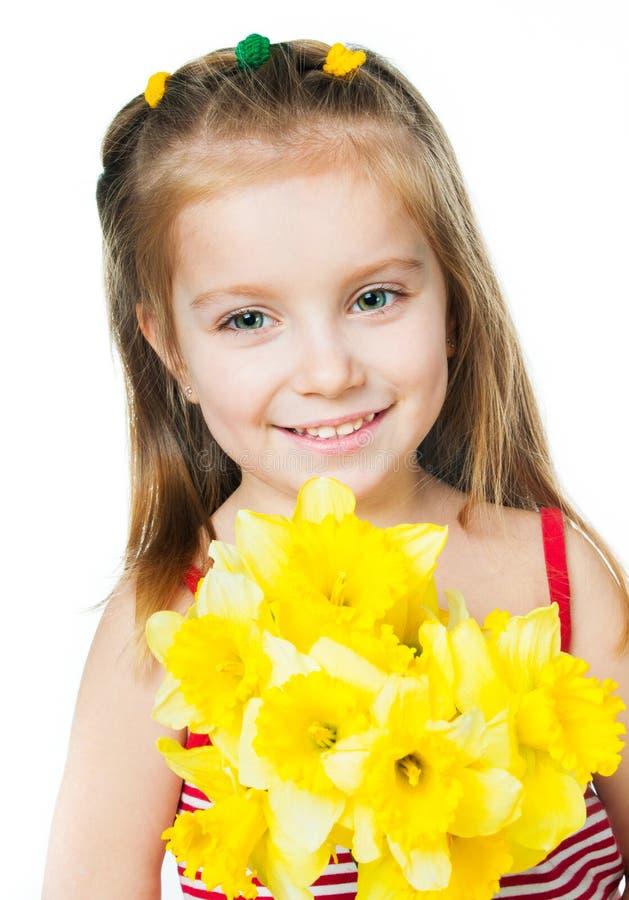 Menina feliz com flores imagens de stock royalty free