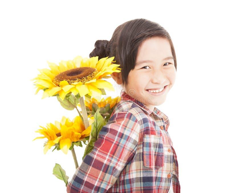 Menina feliz com girassol fotografia de stock royalty free