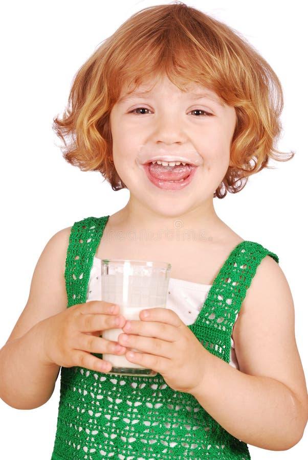 Menina feliz com leite imagens de stock