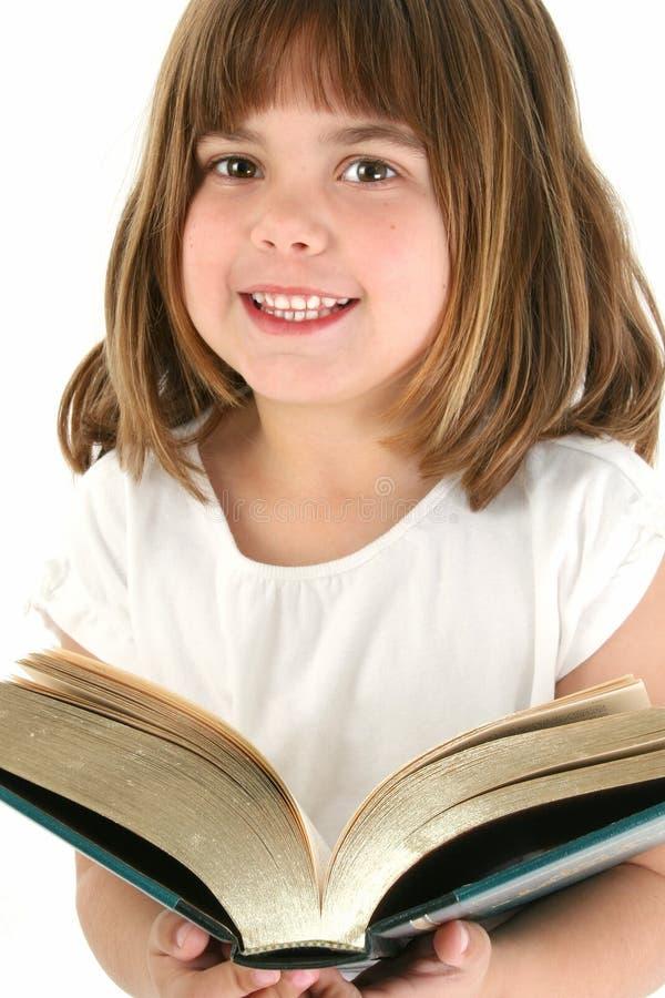 Menina feliz com livro grande fotografia de stock royalty free