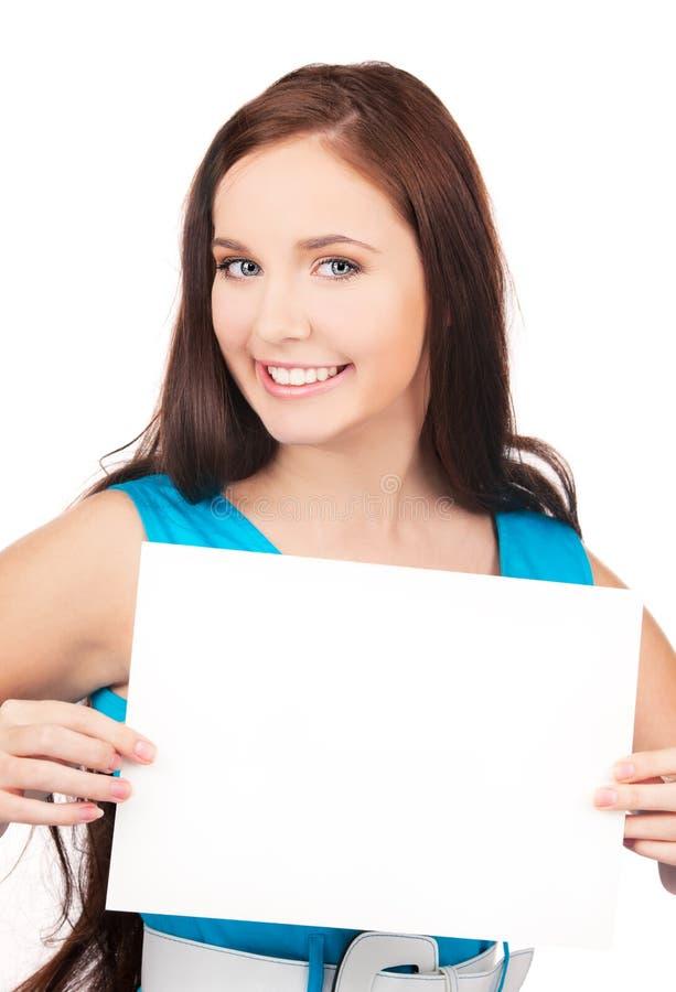 Menina feliz com placa em branco fotografia de stock