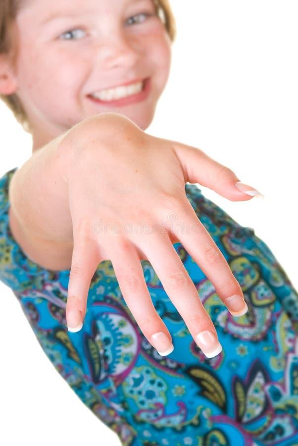 Menina feliz com pregos falsificados foto de stock royalty free