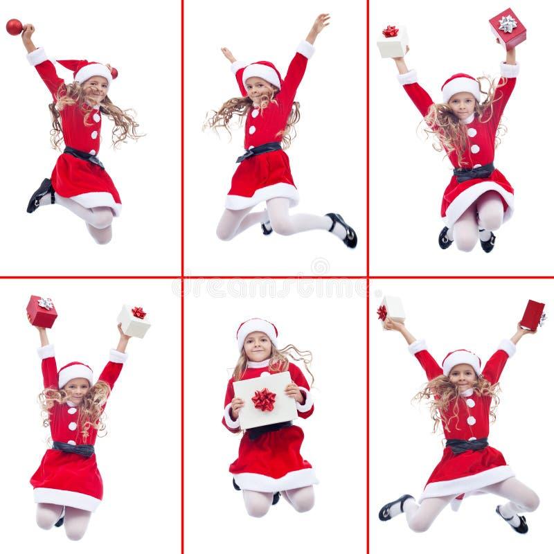 Menina feliz com salto do traje de Santa fotografia de stock