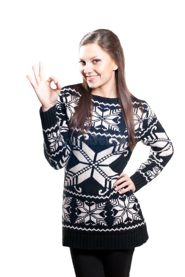 Menina feliz com sinal aprovado foto de stock