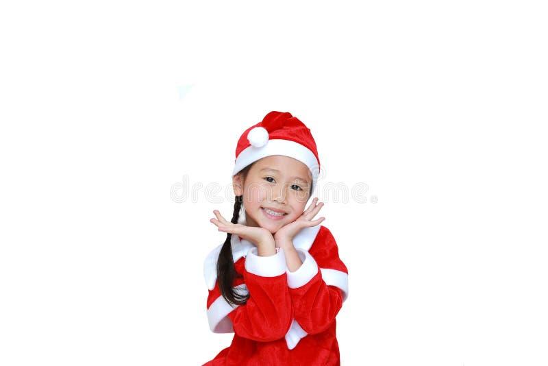 Menina feliz da criança no vestido do traje de Santa com espaço da cópia no fundo branco Conceito do Feliz Natal e do ano novo fe imagem de stock royalty free
