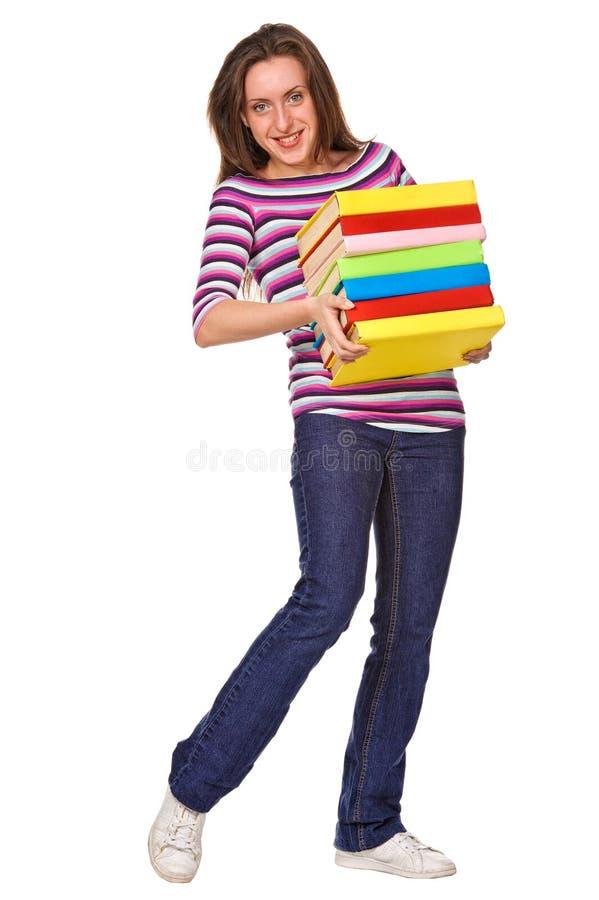 Menina feliz do estudante com o livro da cor da pilha fotos de stock