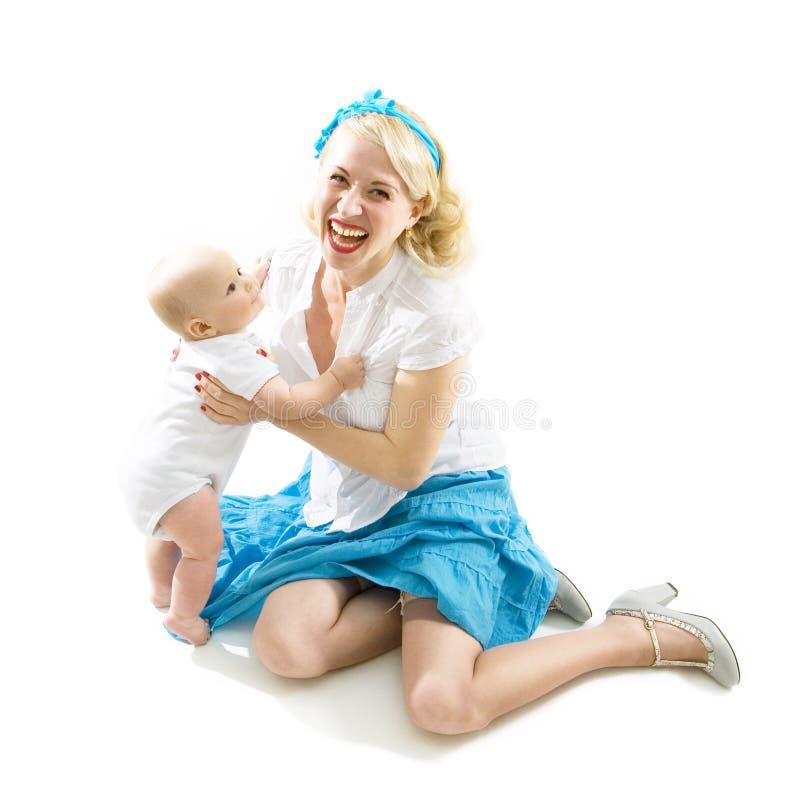 Menina feliz do pino-acima com o bebê isolado no branco imagens de stock