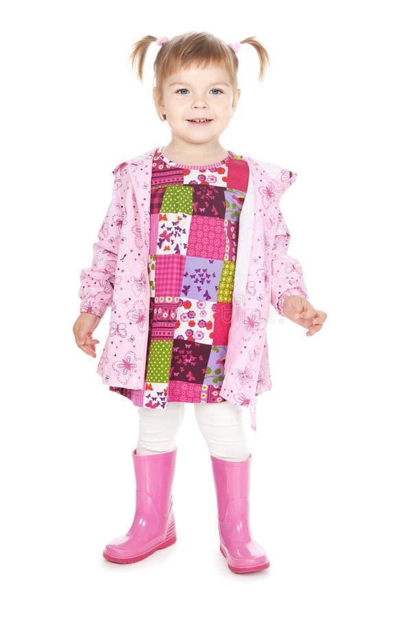 Menina feliz em carregadores cor-de-rosa sobre o branco fotos de stock