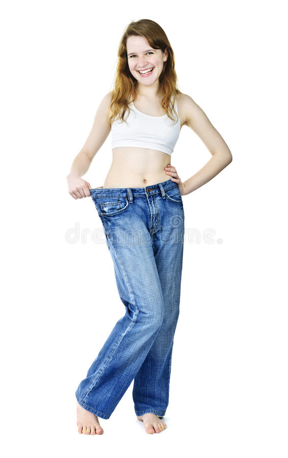 Menina feliz nas calças de brim após peso perdedor foto de stock royalty free