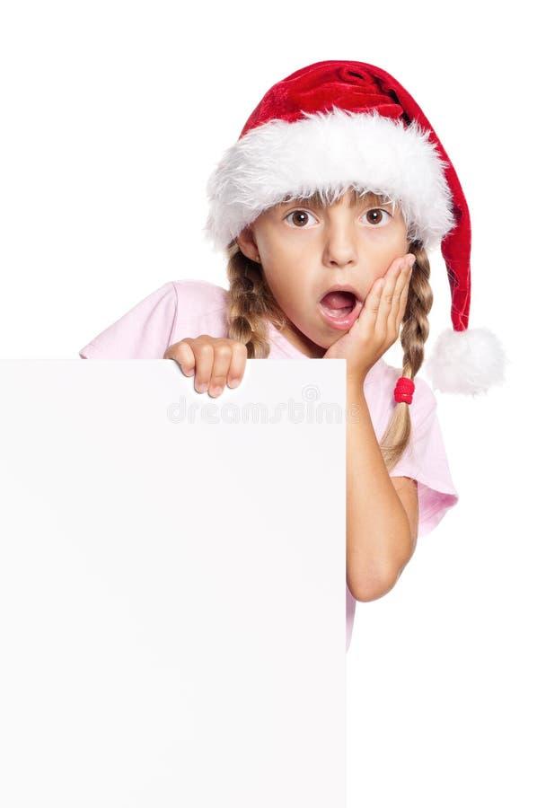 Menina feliz no chapéu de Santa foto de stock royalty free