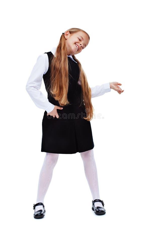 Menina feliz no equipamento à moda com Air Guitar imagens de stock royalty free