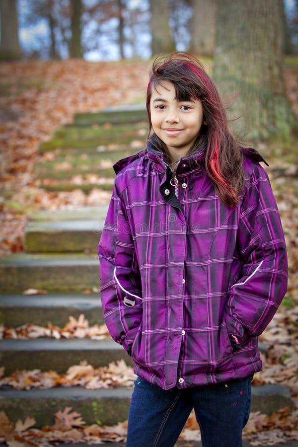 Menina feliz no revestimento colorido foto de stock royalty free