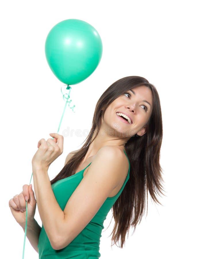 Menina feliz nova com balão verde fotografia de stock