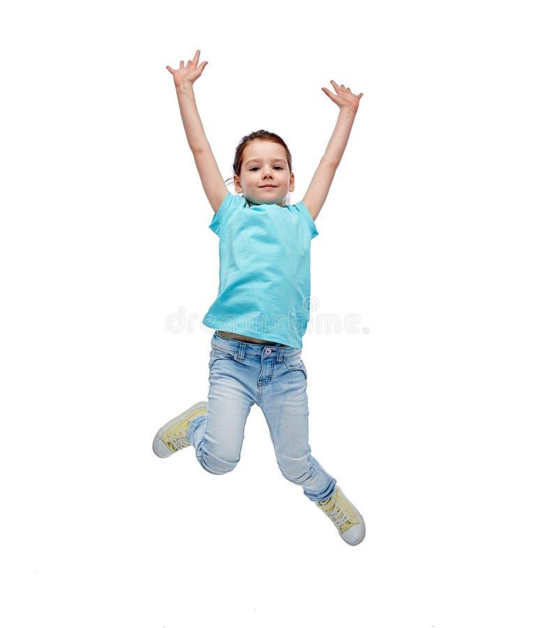 Menina feliz que salta no ar foto de stock royalty free
